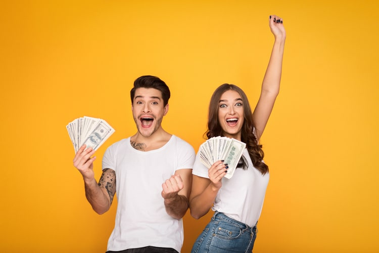Couple holding title loan cash from Nevada Title and Payday Loans, Inc.