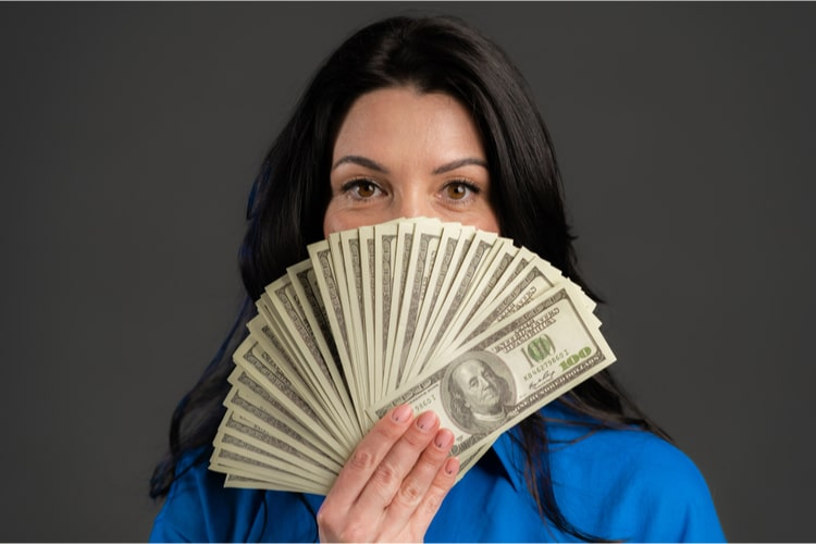 Woman holding title loan cash in Nevada after getting approved.